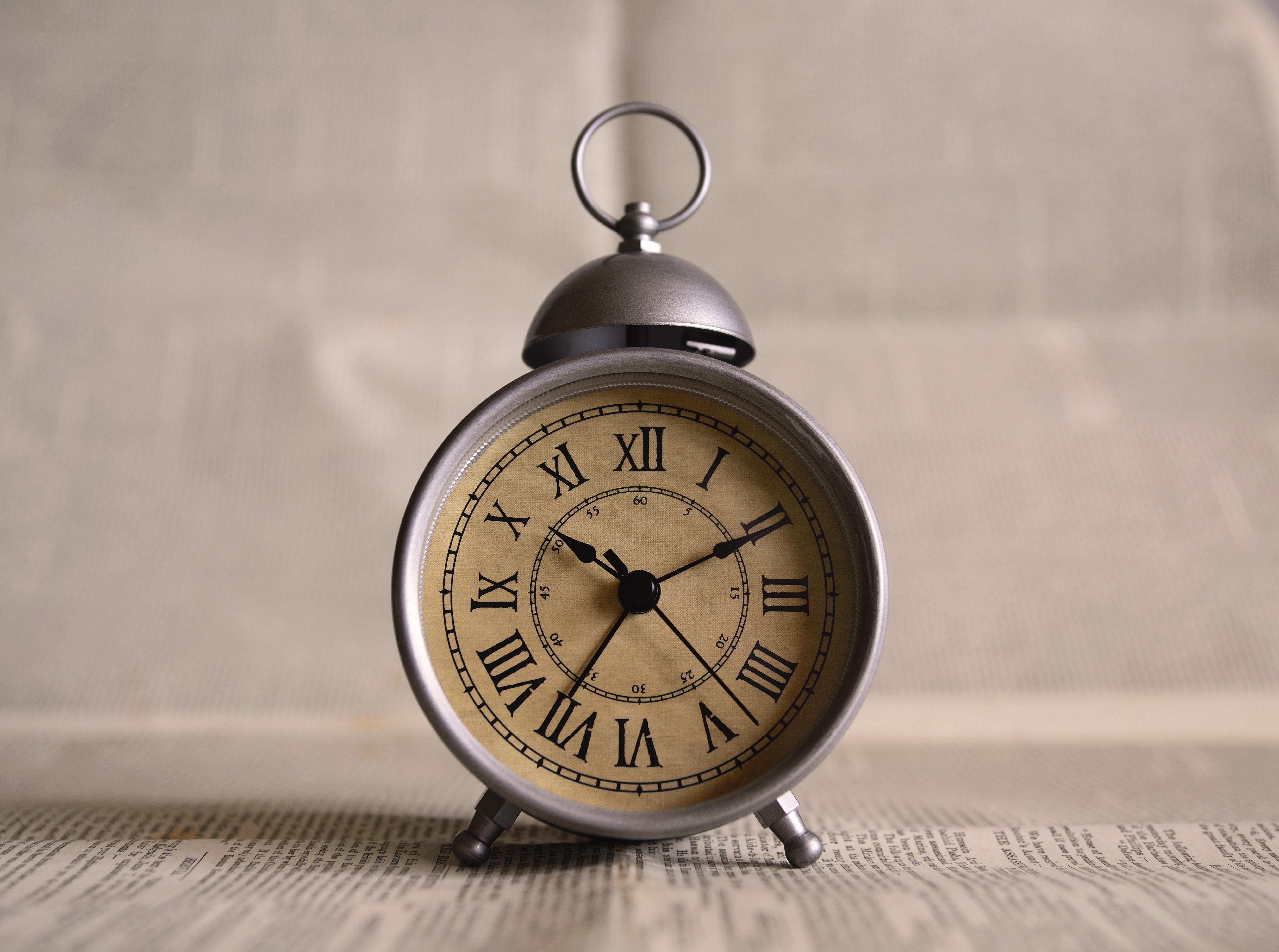 a silver alarm clock