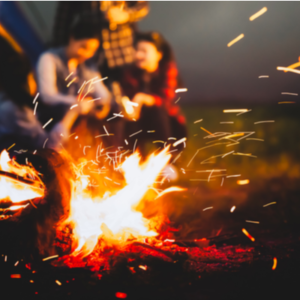 people sitting around a bonfire